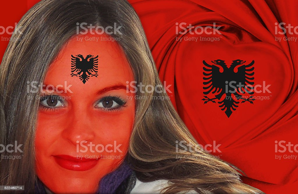 Beautiful Albanian woman in front of flag stock photo
