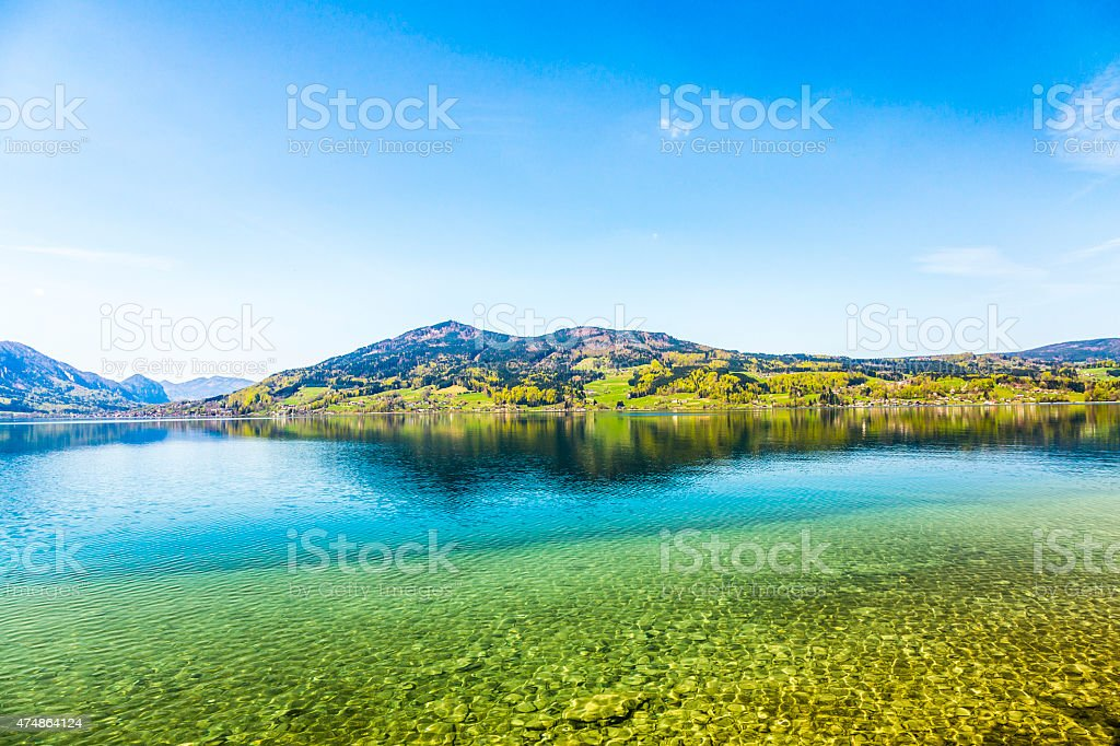 beautiful alpine lake Attersee with crystal water stock photo