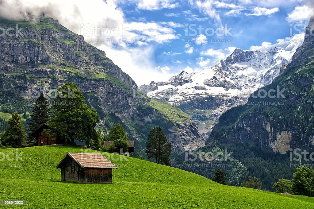 Beautiful alpine landscape with mountains covered by snow in Grindelwald stock photo