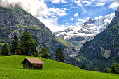 Beautiful alpine landscape with mountains covered by snow in Grindelwald