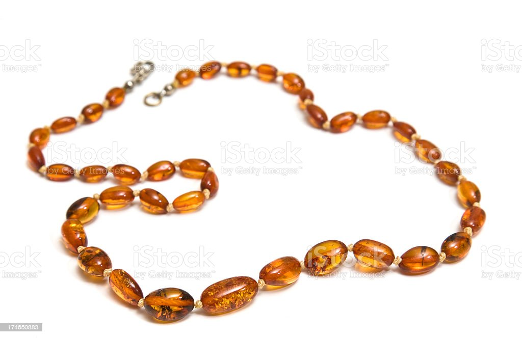 A beautiful Amber necklace on a white background royalty-free stock photo