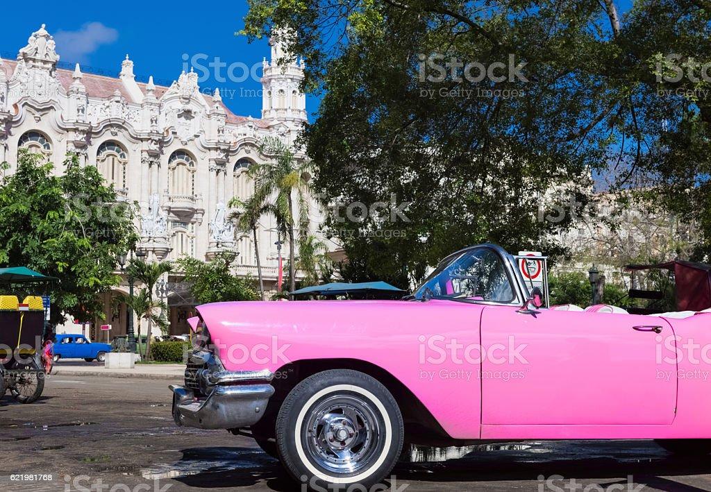 Beautiful american pink classic car parked in Havana City Cuba stock photo