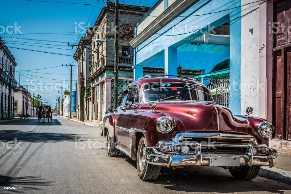 HDR  Beautiful american red classic car in Santa Clara Cuba stock photo