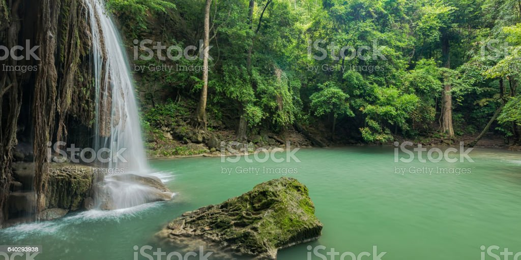 Beautiful and Breathtaking green waterfall at the evergreen forest stock photo