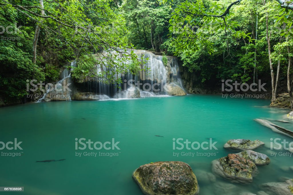 Beautiful and Breathtaking green waterfall in deep forest stock photo