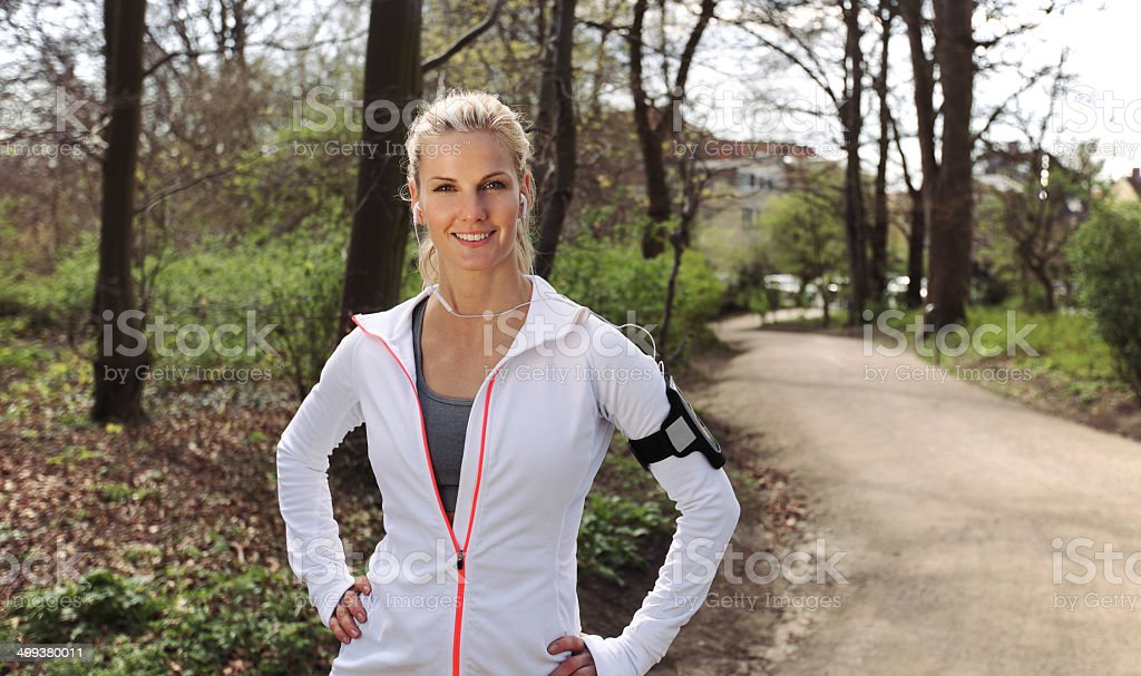 Beautiful and confident female runner outdoors stock photo