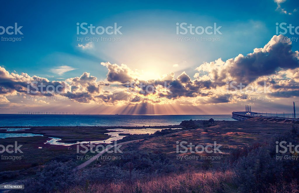 beautiful and dramatic sunset over oresunds bridge from sweden side stock photo
