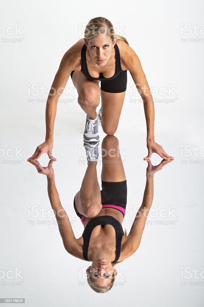 Beautiful and Fit Woman in Sprinter Starting Pose royalty-free stock photo