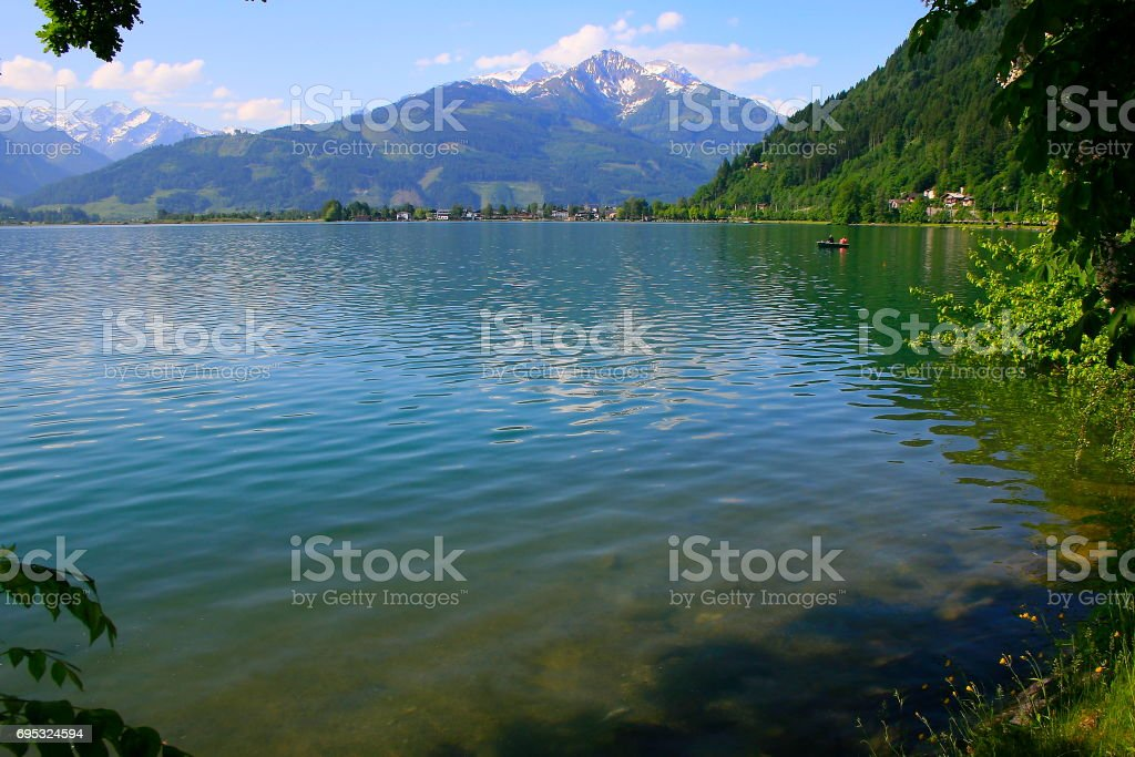 Beautiful and peaceful Zeller lake - Zell am See and Mountain range landscape, Tirol landscape in Austrian Salzburger land, Austria stock photo