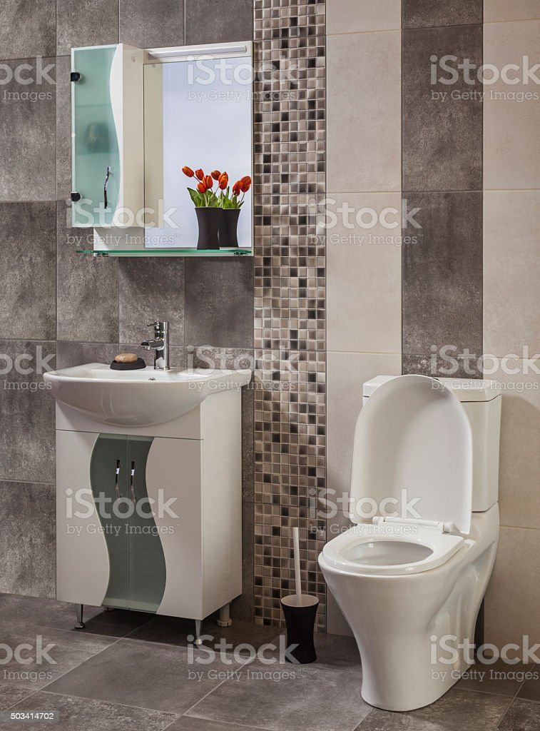 beautiful and stylish bathroom decorated with flowers stock photo