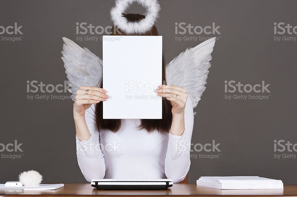 beautiful angel sitting at a table royalty-free stock photo