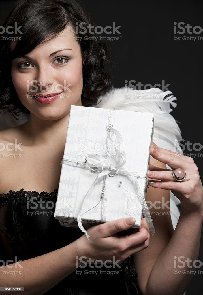 Beautiful angel with gift royalty-free stock photo