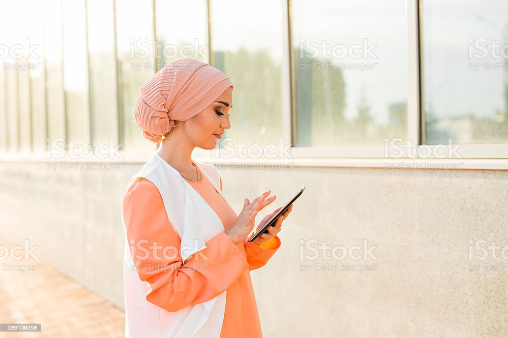 beautiful arabian girl with tablet computer stock photo