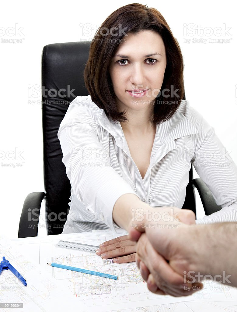 Beautiful architect welcomes a client royalty-free stock photo