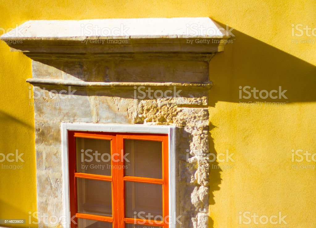Beautiful Architectural Window Detail with Oranges and Yellows, Italy stock photo