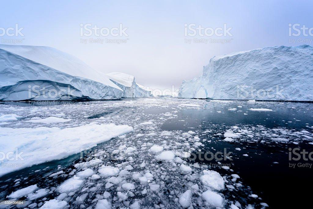 Beautiful Arctic Icebergs in the Greenland arctic sea. stock photo