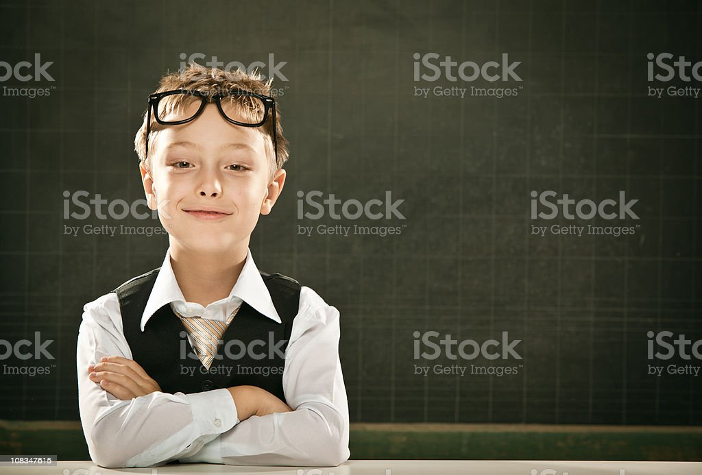 beautiful arms crossed school student kid portrait with blackboa royalty-free stock photo