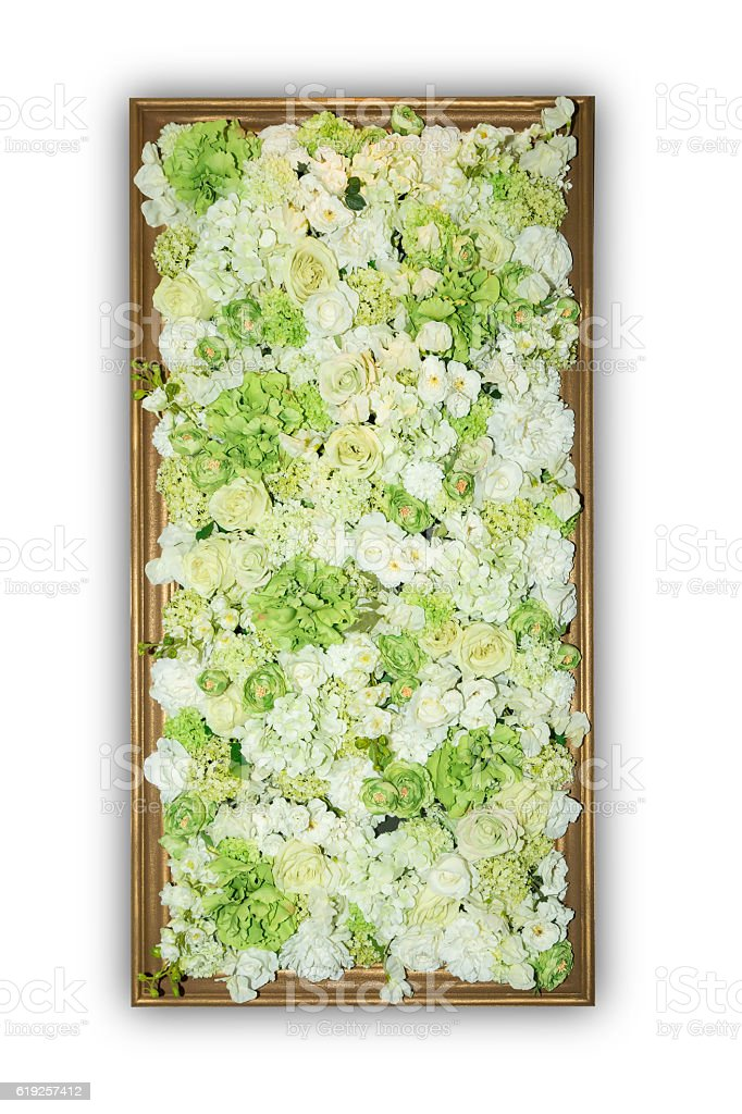 Beautiful artificial flowers in wooden frame. stock photo