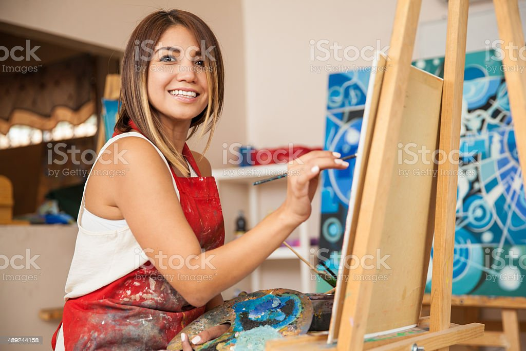 Beautiful artist enjoying her work stock photo