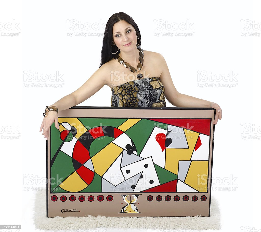 Beautiful artist holding with two hands her painting Obsession stock photo