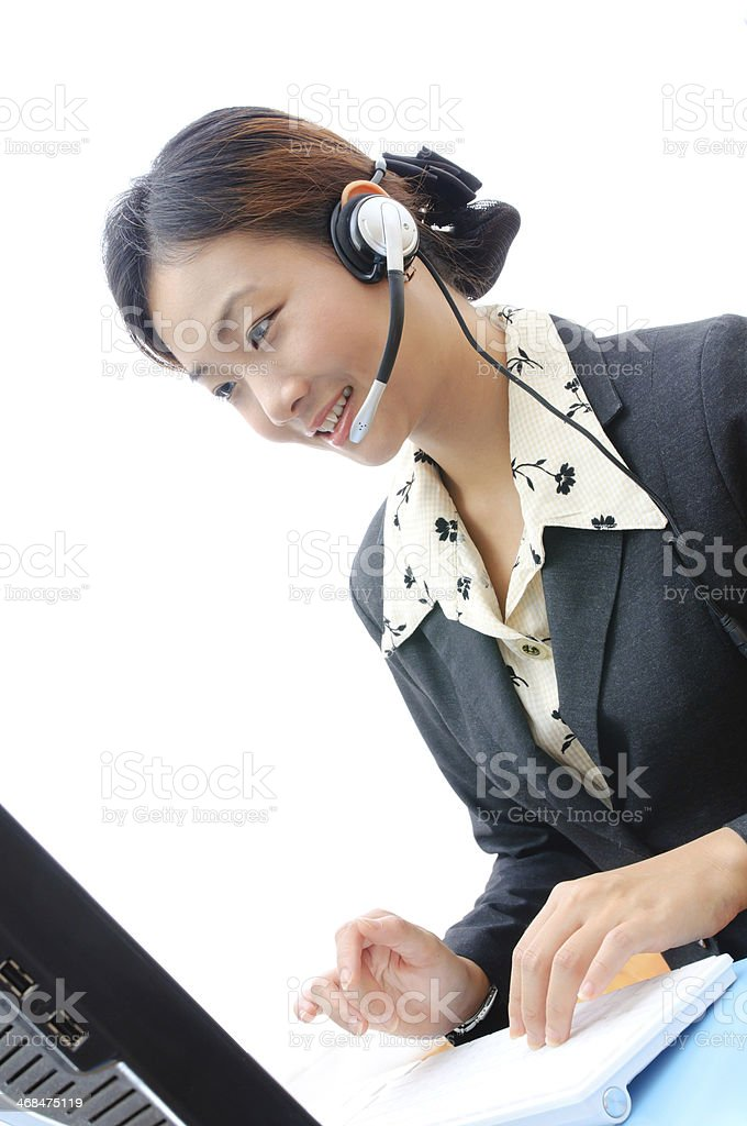 Beautiful asia young business woman with headset and computer is royalty-free stock photo
