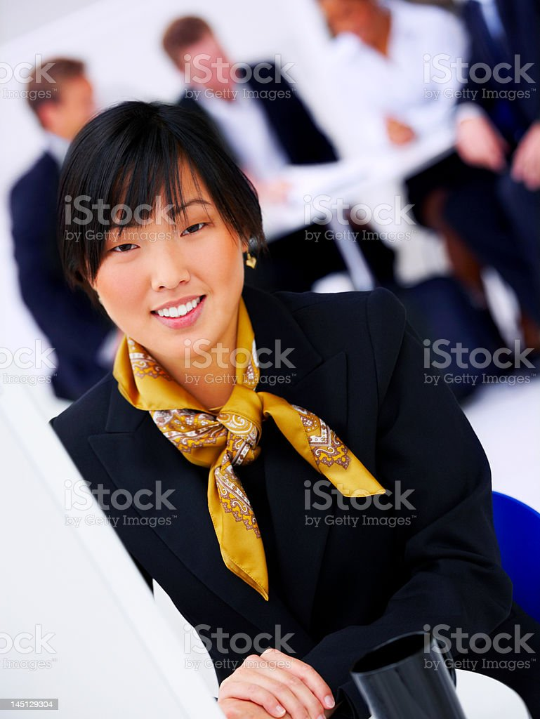 Beautiful asian businesswoman smiling royalty-free stock photo