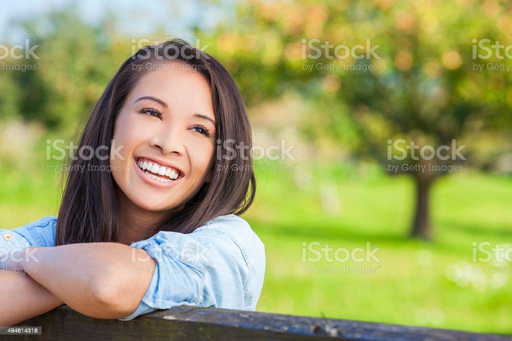 Beautiful Asian Eurasian Girl Smiling with Perfect Teeth stock photo