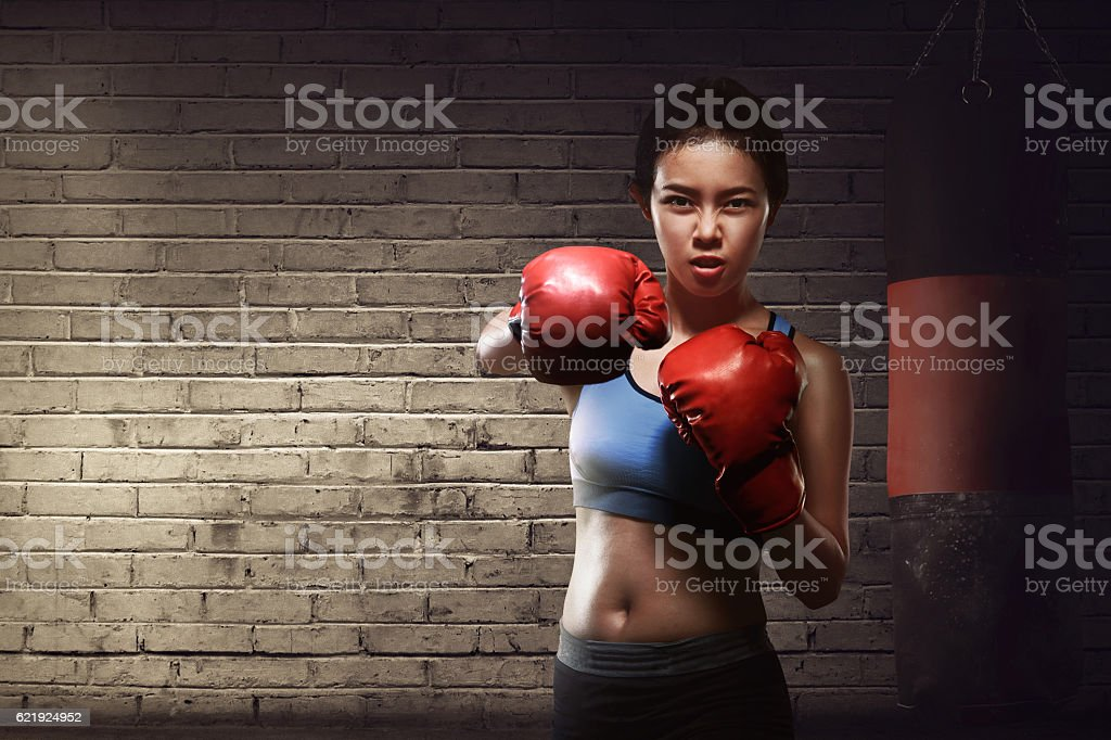 Beautiful asian female training punch with boxing gloves stock photo