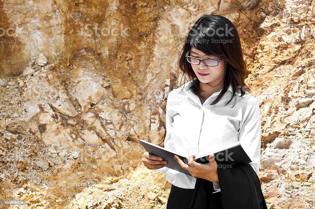 Beautiful Asian geologist woman. stock photo