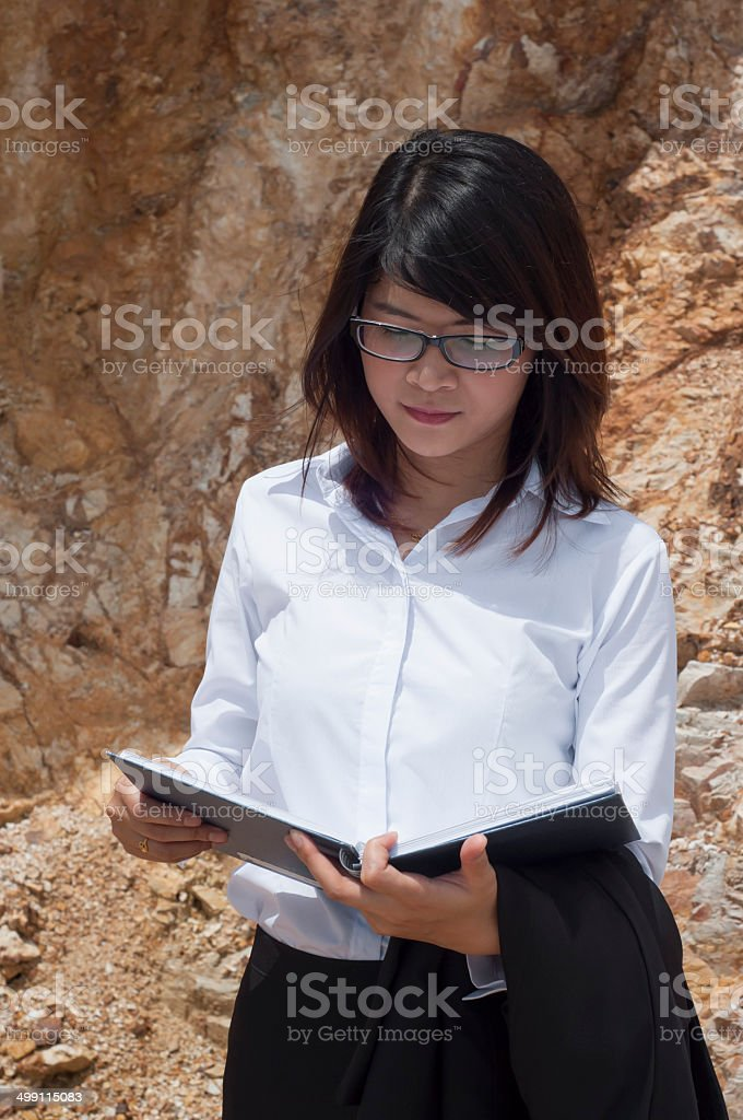 Beautiful Asian geologist woman researching in working site. stock photo