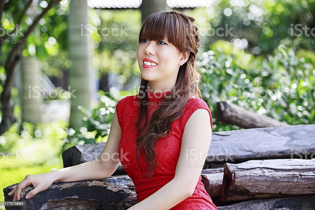 Beautiful Asian Girl in Red Dress royalty-free stock photo