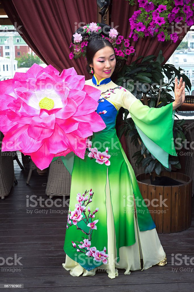 Beautiful Asian girl in traditional Chinese dress and floral parasol stock photo