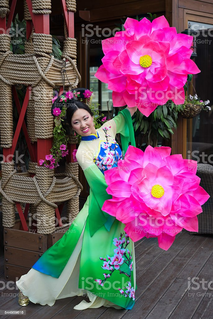 Beautiful asian girl in traditional chinese green and blue dress stock photo
