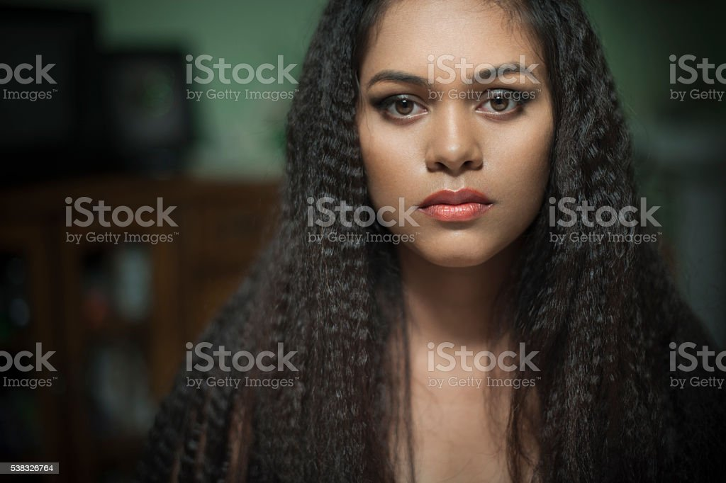 Beautiful Asian girl looking at camera with blank expression. stock photo