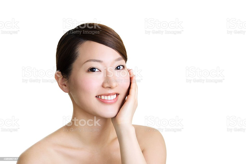Beautiful asian girl smiling and touching her face. stock photo