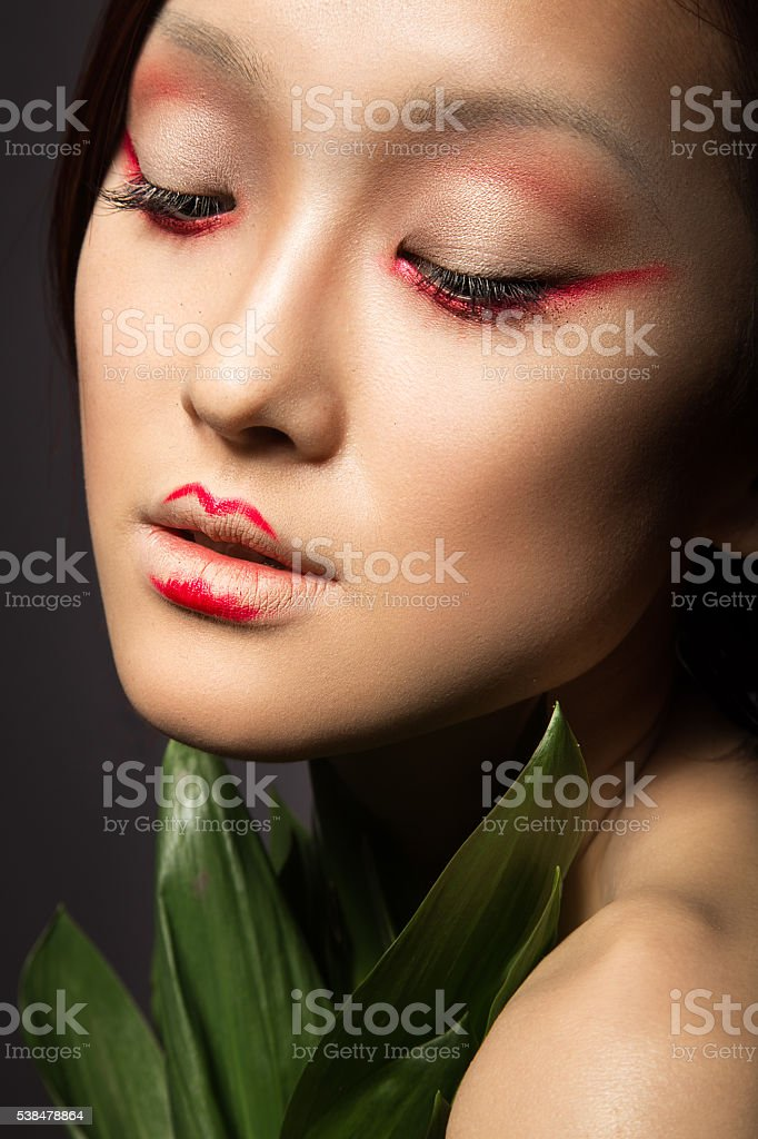 Beautiful Asian girl with a bright make-up art in stock photo
