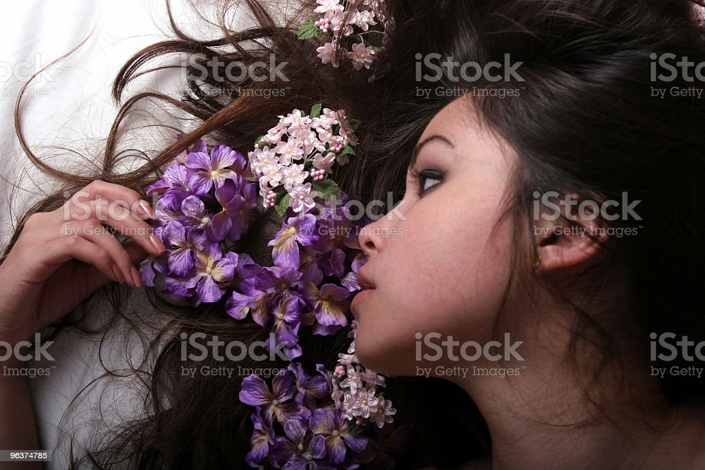 Beautiful Asian girl with flowers on her hair royalty-free stock photo