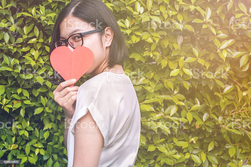 Beautiful asian girl with take a heart for Valentines day stock photo