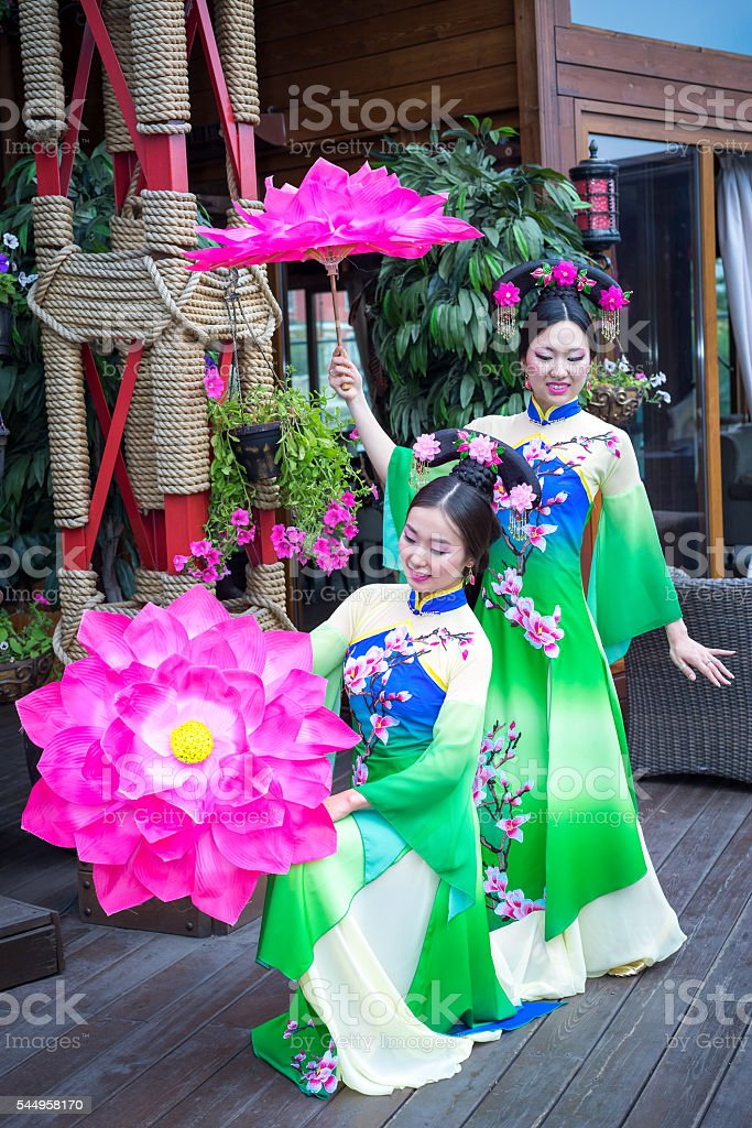 beautiful asian girls in traditional chinese blue and green dresses stock photo