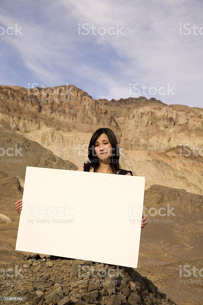 beautiful asian model holding board royalty-free stock photo