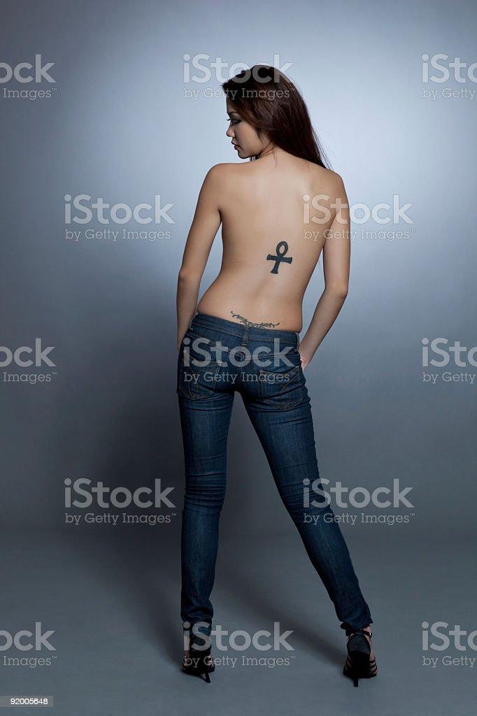 Beautiful asian model in denim jeans royalty-free stock photo