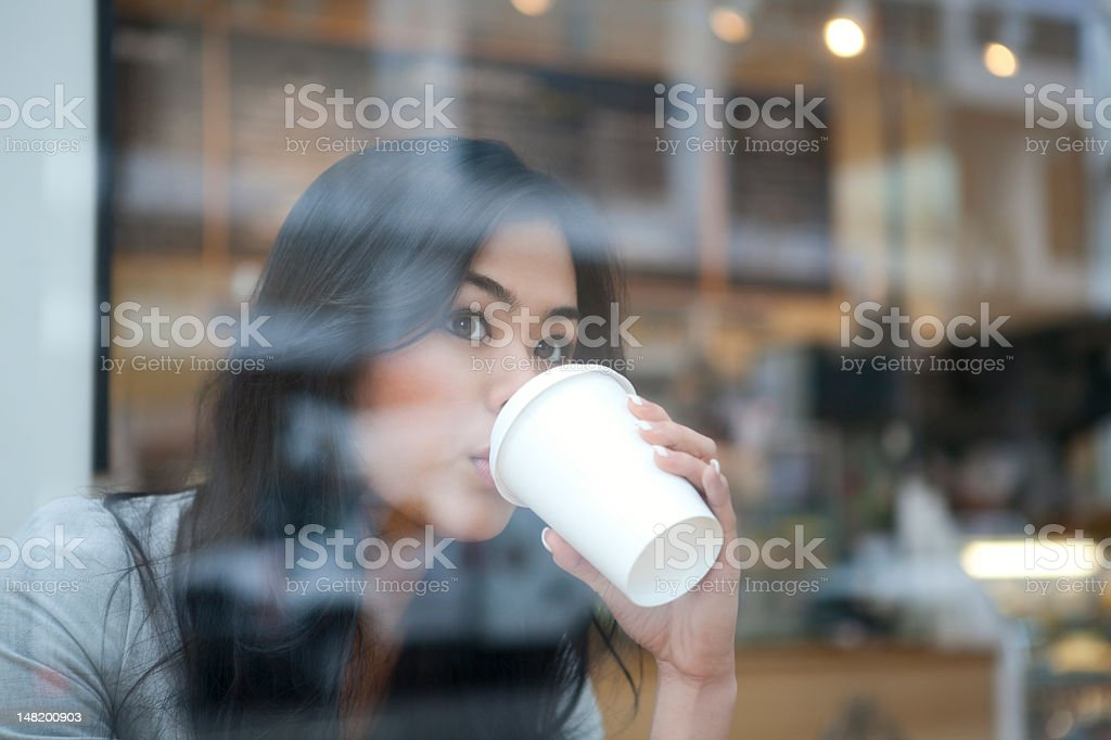 Beautiful Asian woman drinking cup of coffee royalty-free stock photo