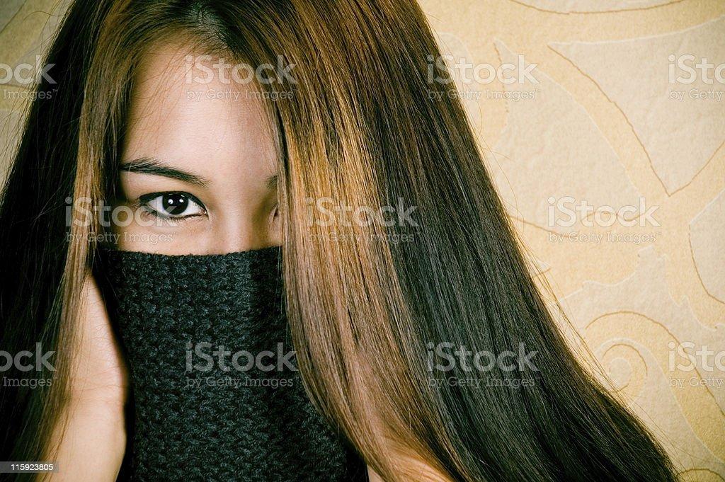 Beautiful Asian woman hiding her face. royalty-free stock photo