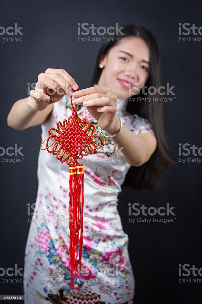 Beautiful asian woman holding a Chinese knot stock photo