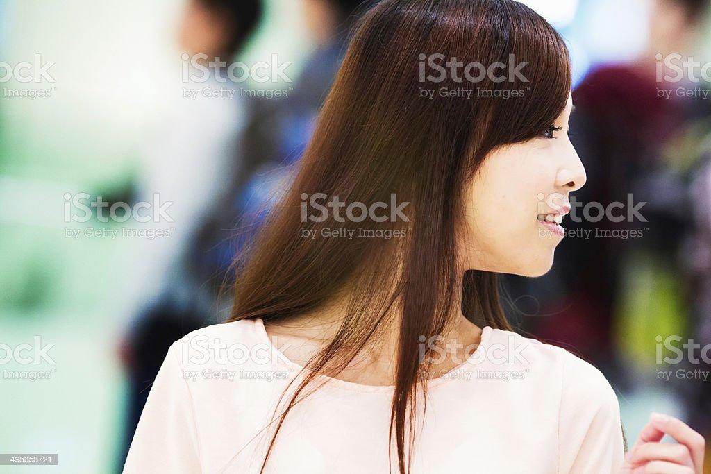 Beautiful Asian woman in a crowd stock photo