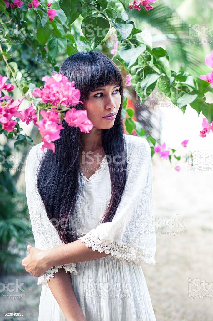 Beautiful asian woman in long white dress stock photo