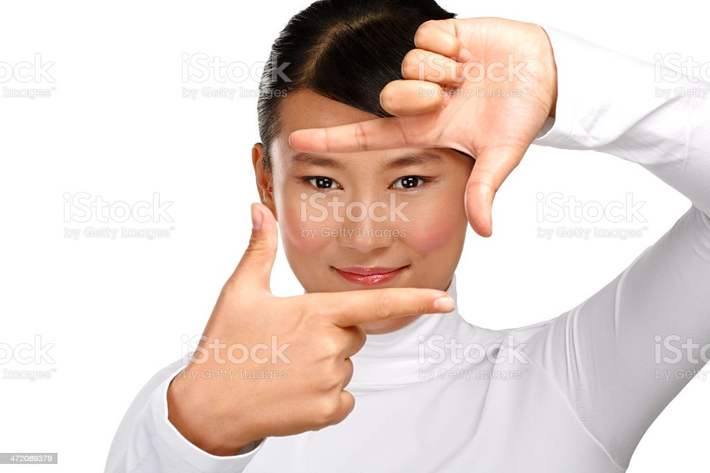 Beautiful asian woman make a frame shot symbol with  hands royalty-free stock photo