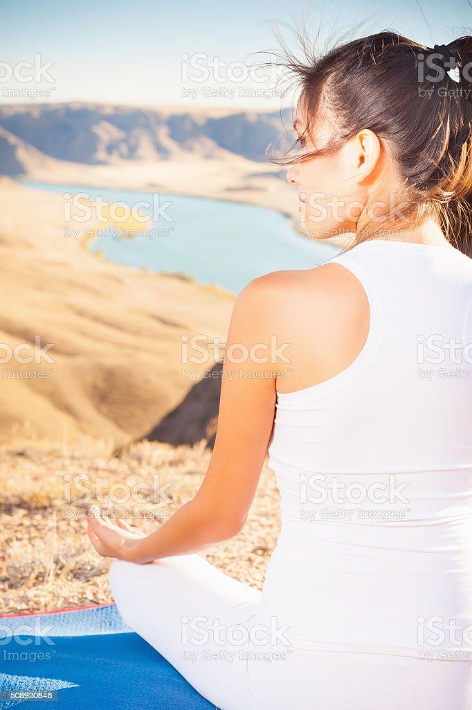 Beautiful asian woman relaxing and meditating outdoor at mountai stock photo