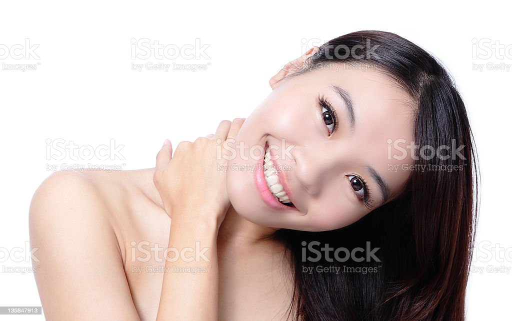 Beautiful asian woman smile touching her shoulders royalty-free stock photo
