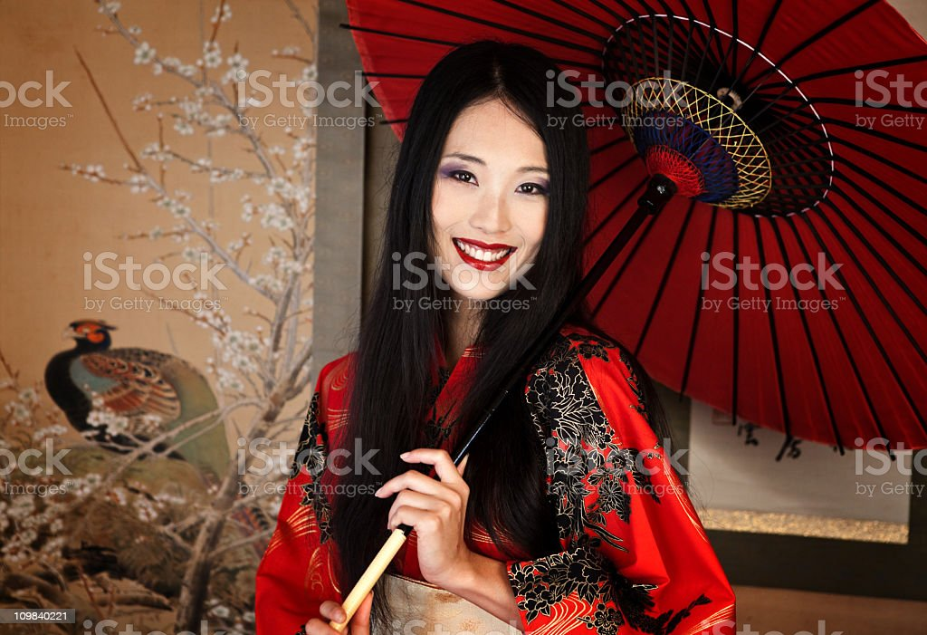 Beautiful asian woman with a red umbrella stock photo